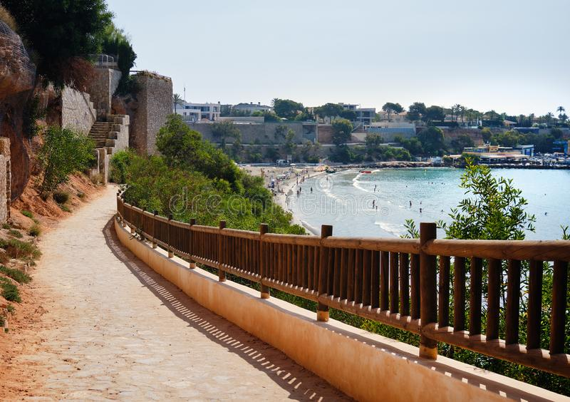 Empty fenced walkway leading to the Cabo Roig beach royalty free stock photos
