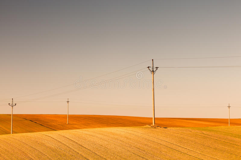 Empty field. Power-transmission poles on the empty field in spring royalty free stock photography