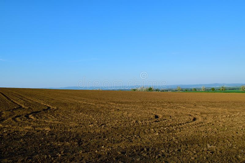 Empty field in sprig. Empty field in spring, blue sky, rural countryside royalty free stock images