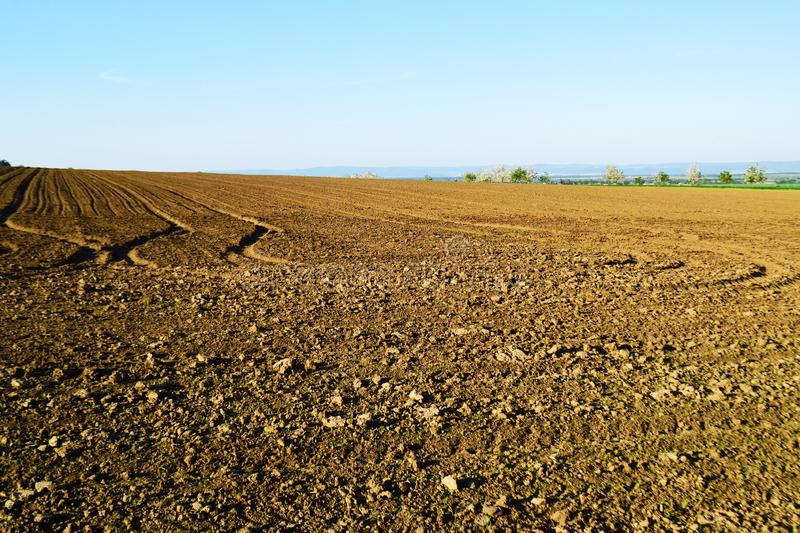 Empty field in spring. Empty field plowed in spring, agriculture stock photography