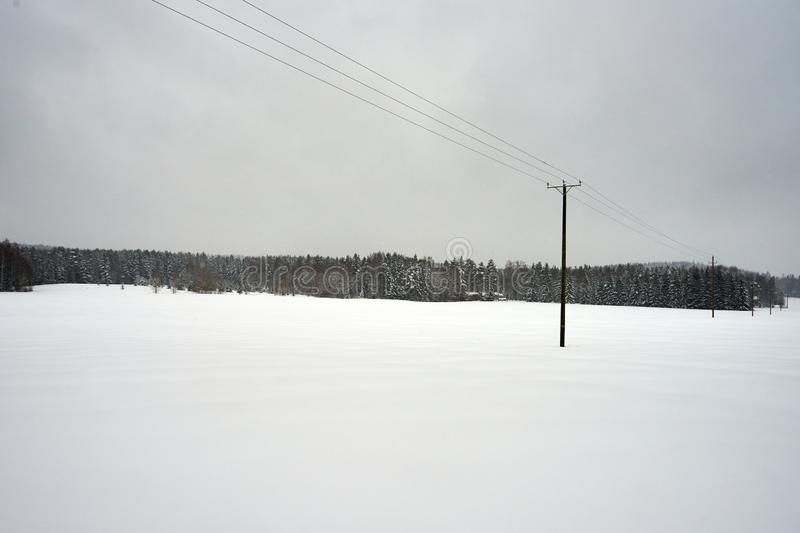 Empty fields in winter day stock photography