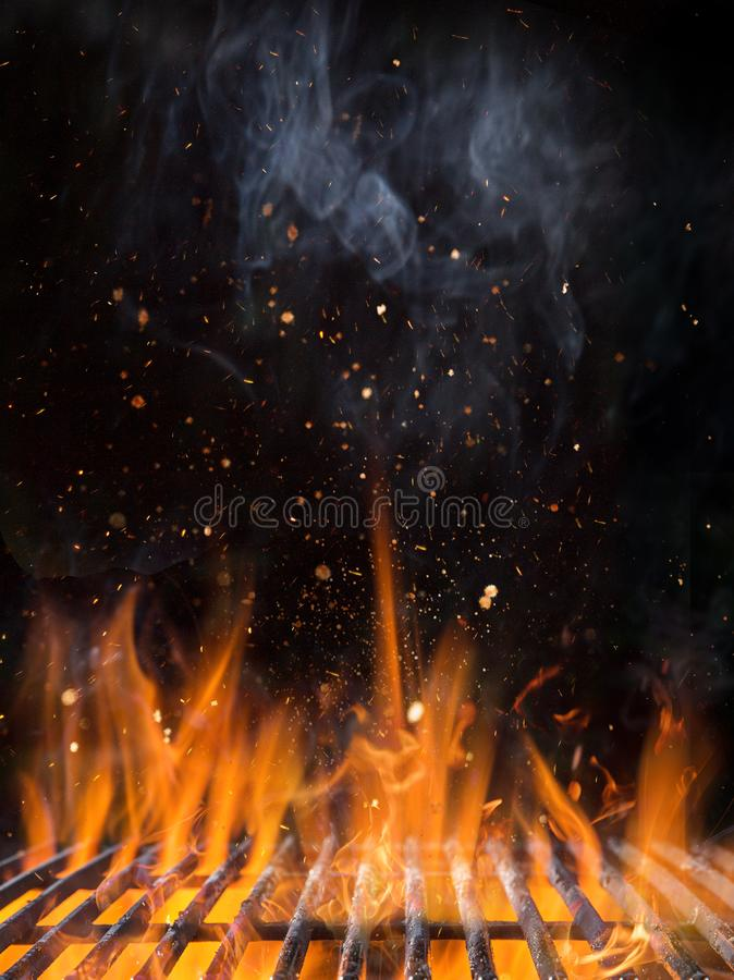 Empty flaming charcoal grill with open fire. Empty flaming charcoal grill with open fire, ready for product placement royalty free stock photos