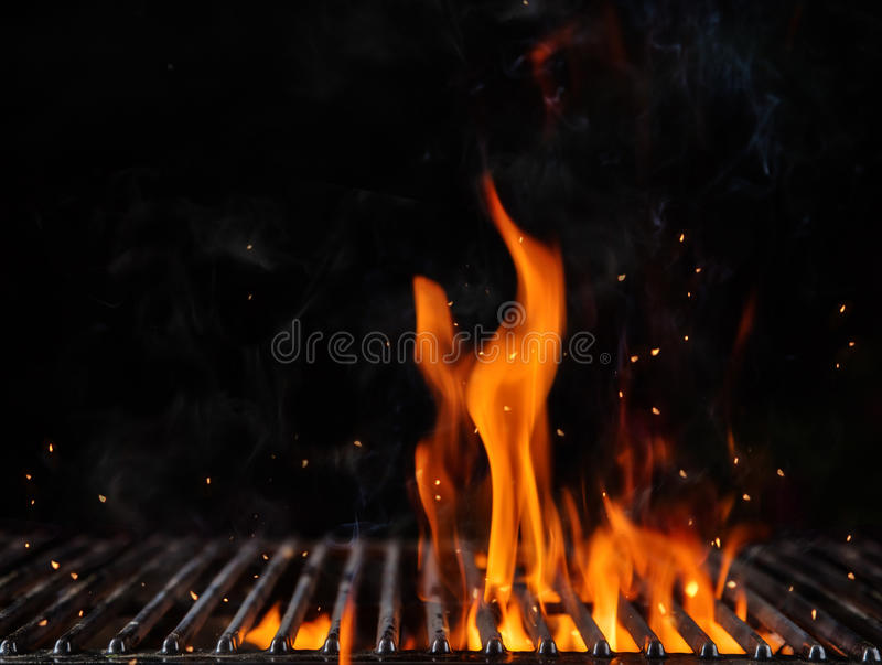 Empty flaming charcoal grill with open fire. Ready for product placement. Concept of summer grilling, barbecue, bbq and party. Black copyspace stock photography