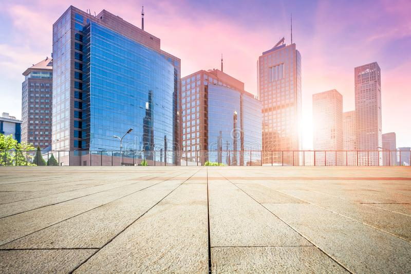 Empty floor and modern building with sunbeam royalty free stock photo