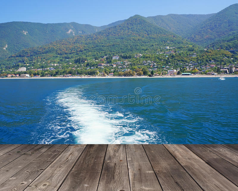 Empty flooring against a foamy trace in the sea. stock image