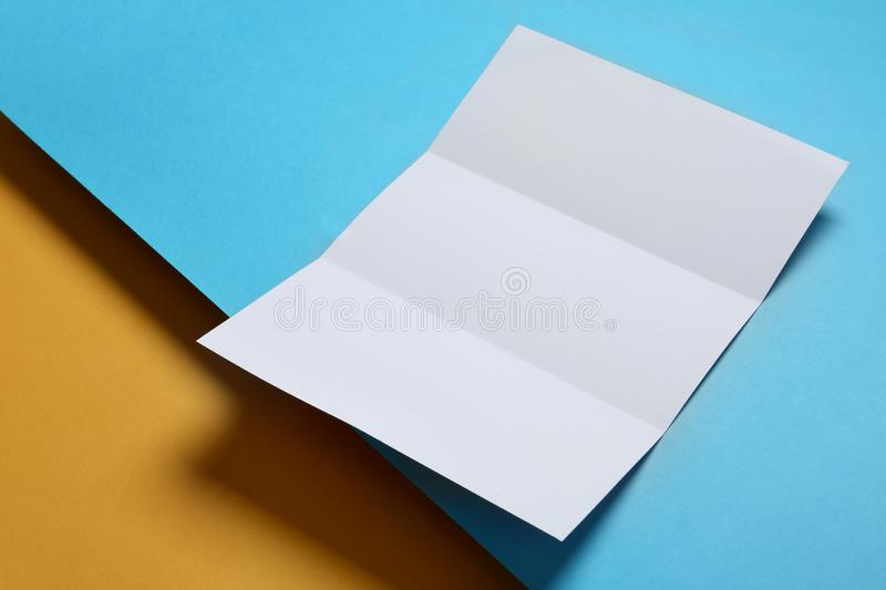 Empty flyer on background. Mockup for design. Empty flyer on color background. Mockup for design royalty free stock photo