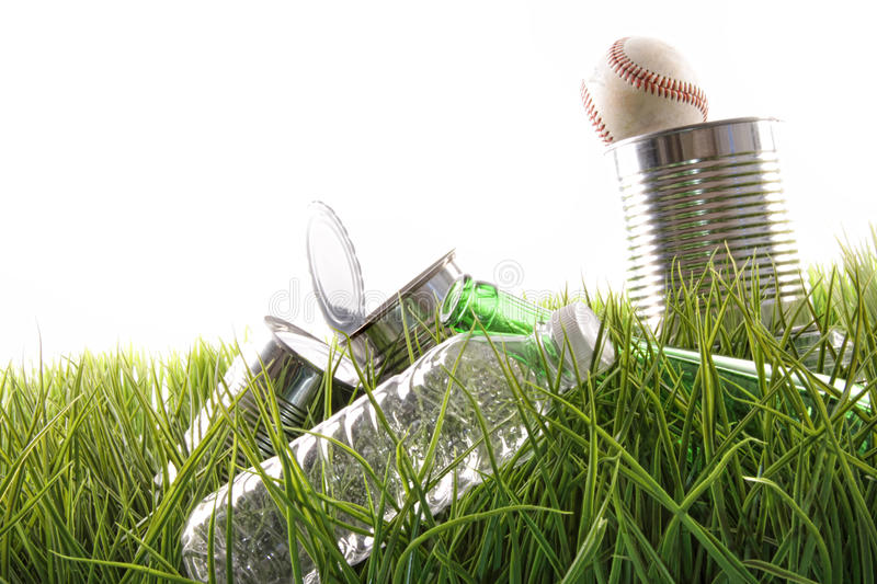 Download Empty Food Cans, Bottles And Baseball In Grass Stock Photo - Image: 13466630