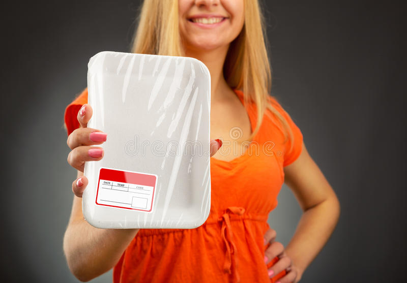 Empty food tray. Young blondie woman holding empty food tray stock image