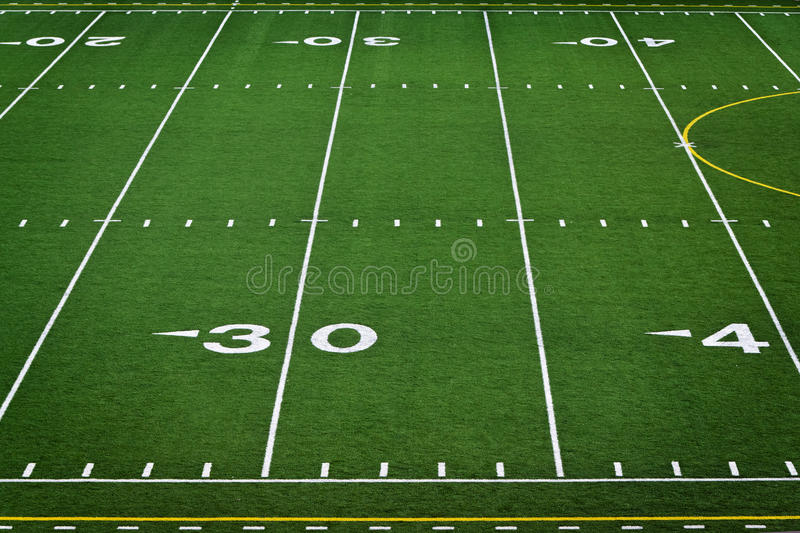 Empty football field. An empty high school football field stock photos