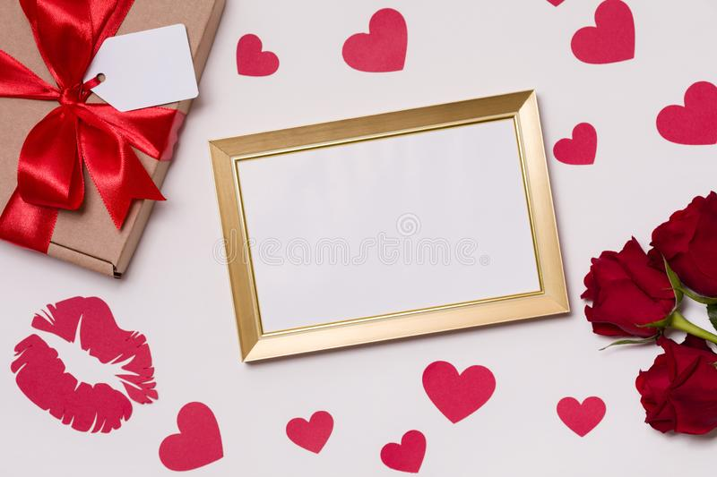 Valentines day,empty frame,seamless white background,red roses,hearts,message,free copy text space stock photography