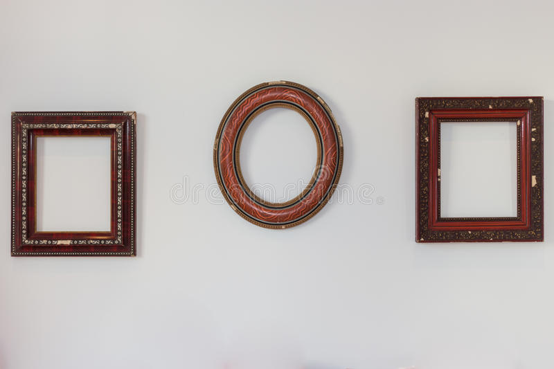 Empty Frames on the Wall. Empty Wood Frames on a White Wall royalty free stock images