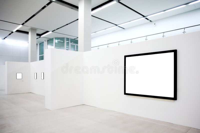 Empty frames on white wall royalty free stock photo