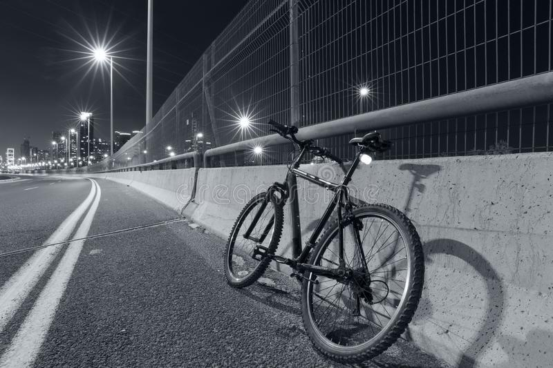 Empty Freeway and Bicycle At Night Road. Empty Freeway and  Bicycle At Night Road - Black and White toned royalty free stock images