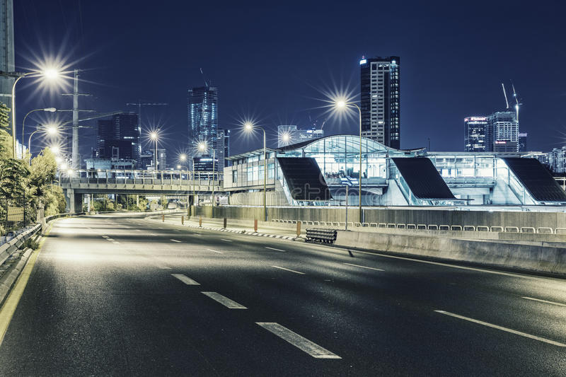 Empty freeway at night And Tel Aviv Cityscape royalty free stock photo