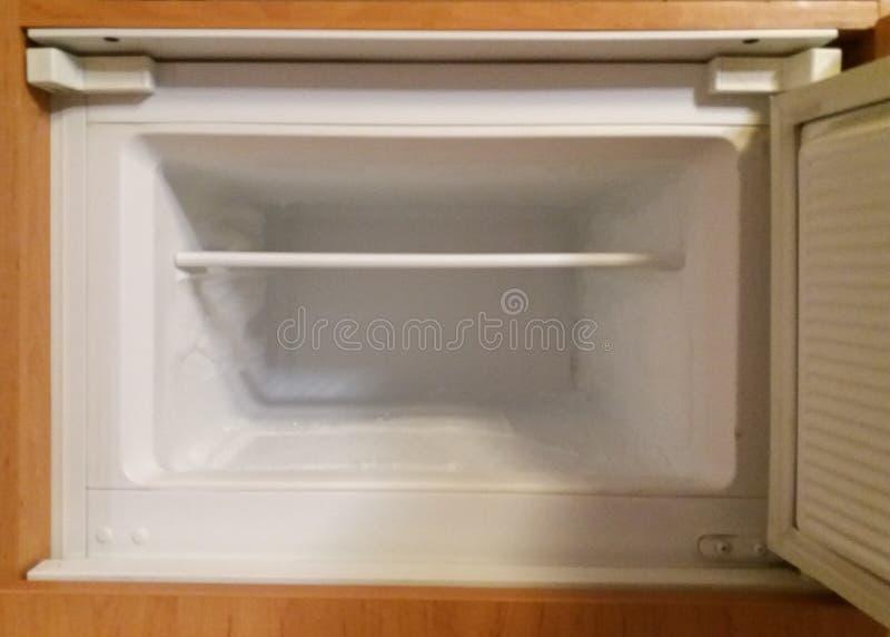 Empty freezer compartment. Perspective detail of an empty freezer compartment stock image