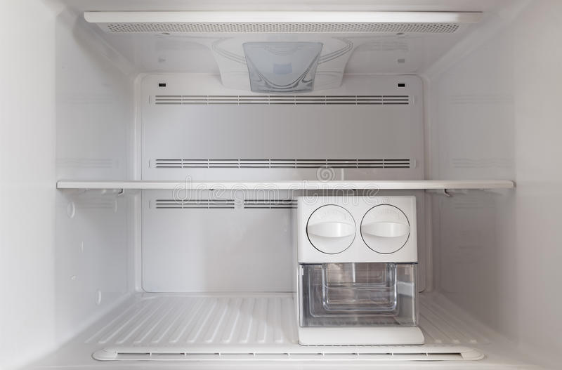 An empty freezer fridge. Compartment for ice cubes stock photo