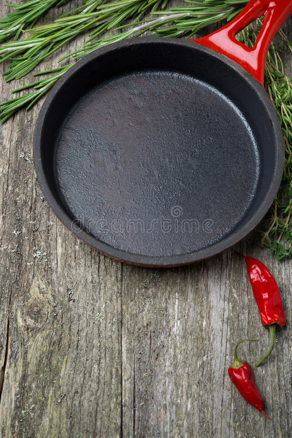 Download Empty Frying Pan And Herbs On A Wooden Background Stock Photo - Image: 33281884