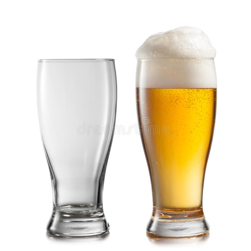 Empty and full glasses of beer isolated on white stock photos