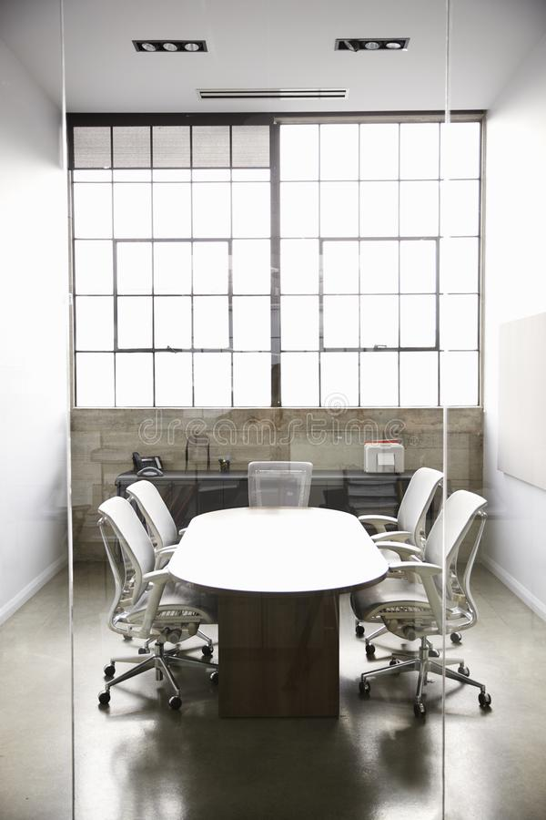 Empty, fully furnished business meeting room stock image