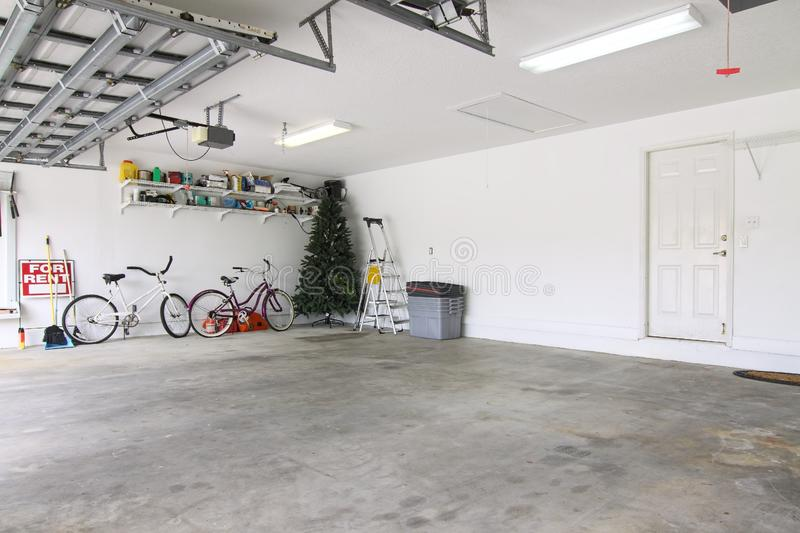 Almost empty garage. An almost empty garage to be used as storage for junk that will be collected over the years