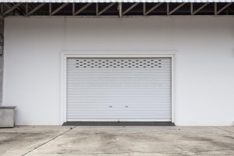 Empty garage with Shutter door or roller door and concrete floor. Industrial building,Empty underground royalty free stock photo