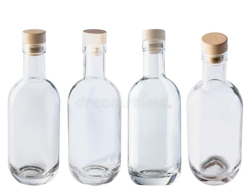 Empty glass bottle with cork. Four different angles. Isolate on a white background. stock photos