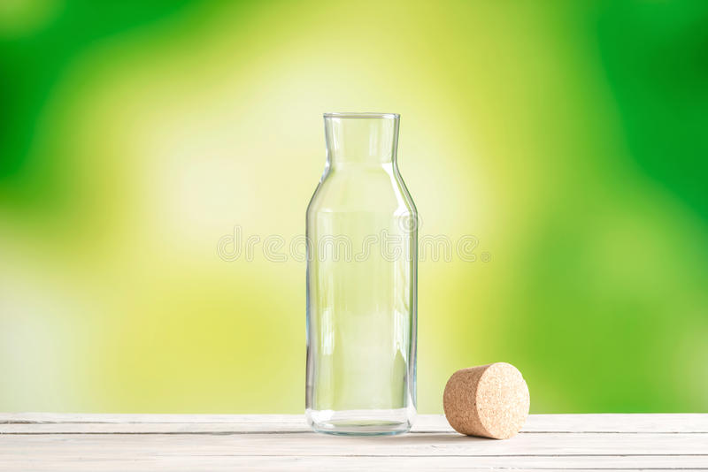 Empty glass bottle with a cork stock photography