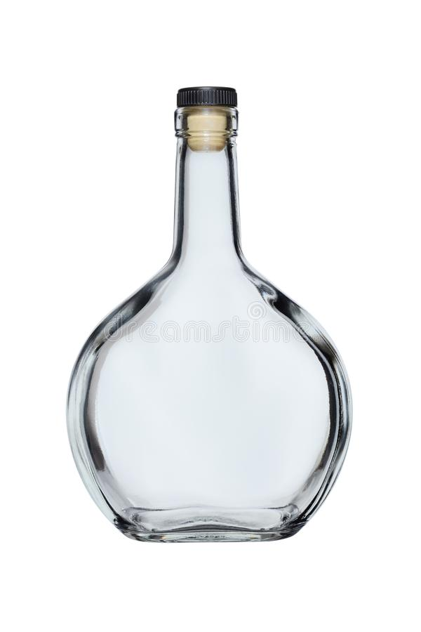 Empty glass bottle of rounded shape closed with a cork, isolated on a white background royalty free stock photo
