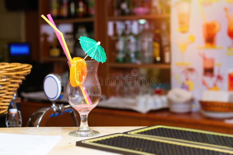 Empty glass from cocktail with umbrella stock photo