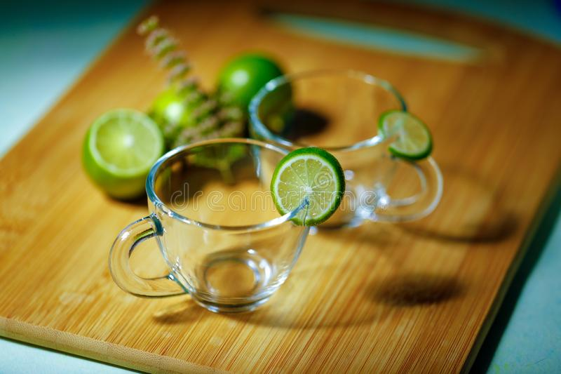 Empty glass cup with lemon stock image