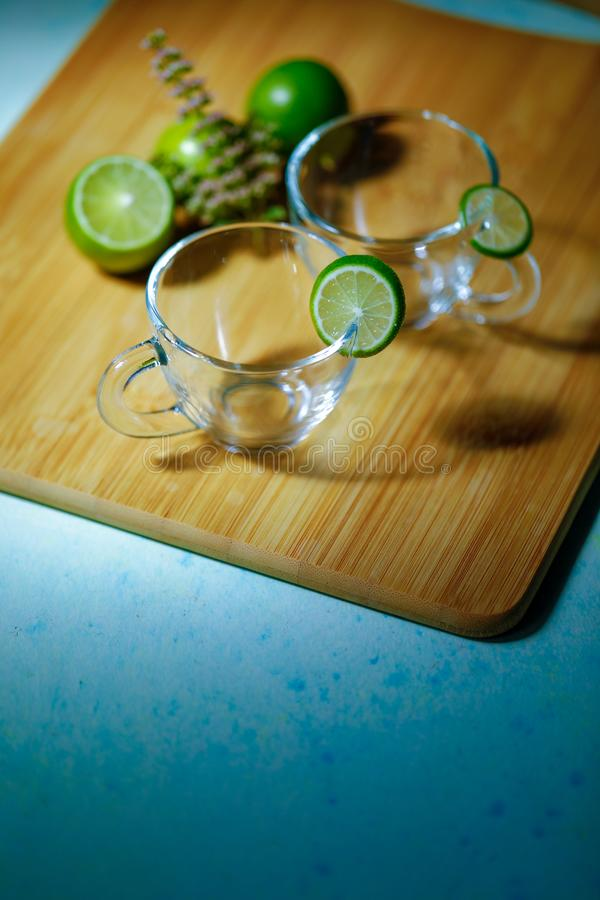 Empty glass cup with lemon stock images