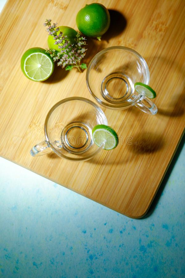 Empty glass cup with lemon stock photo