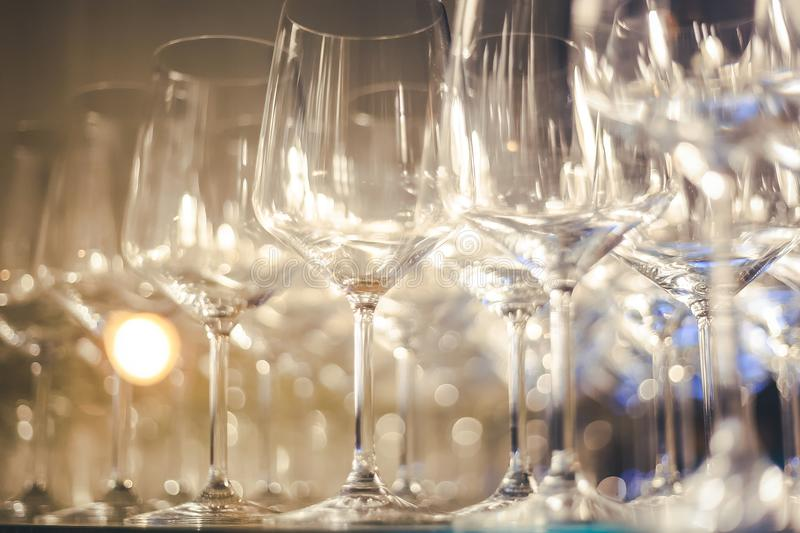 Empty glass glasses on the shelf, abstract background and texture, image with soft focus royalty free stock photo