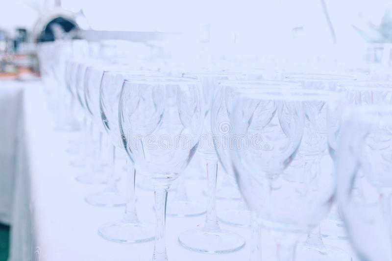 Empty glass glasses on the table in the restaurant royalty free stock image