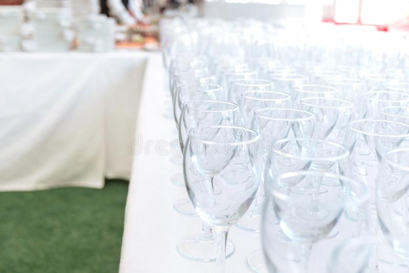 Empty glass glasses on the table in the restaurant. Festive reception royalty free stock image