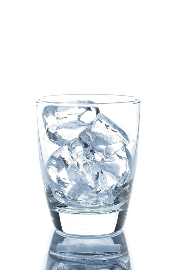 Empty glass with ice cubes. On white background stock photos