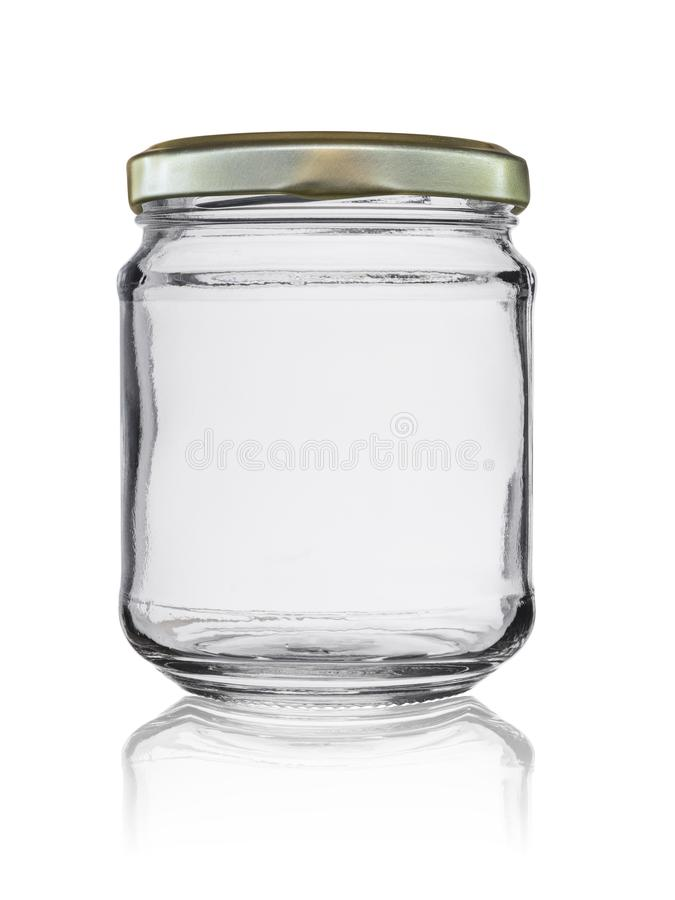 Empty glass jar closed by a metal cover with reflection, isolated on a white background stock photography
