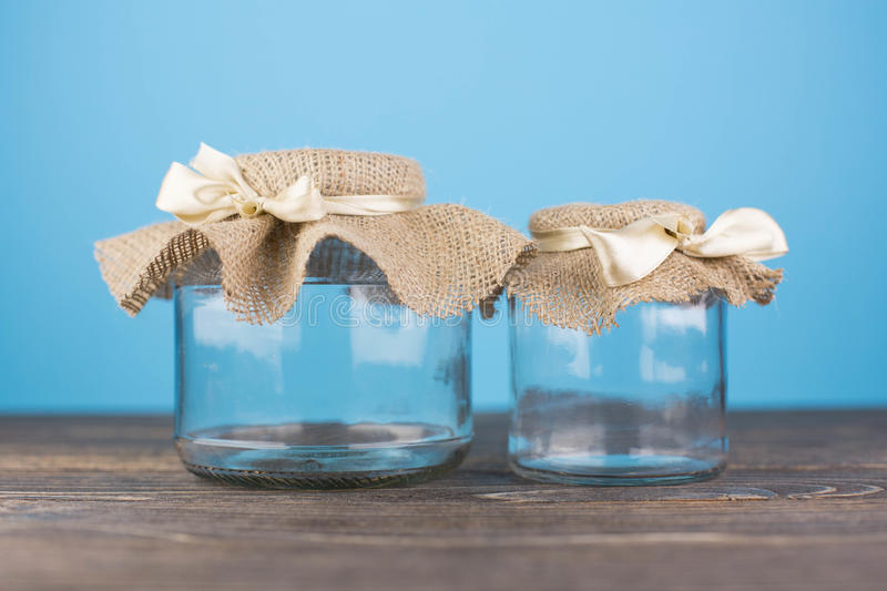 Empty glass jar with packaging sacking stock photography
