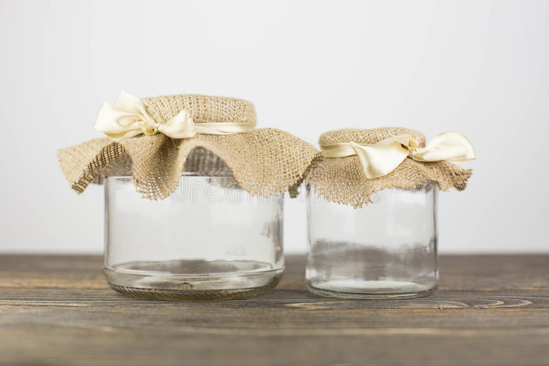 Empty glass jar with packaging sacking royalty free stock photo