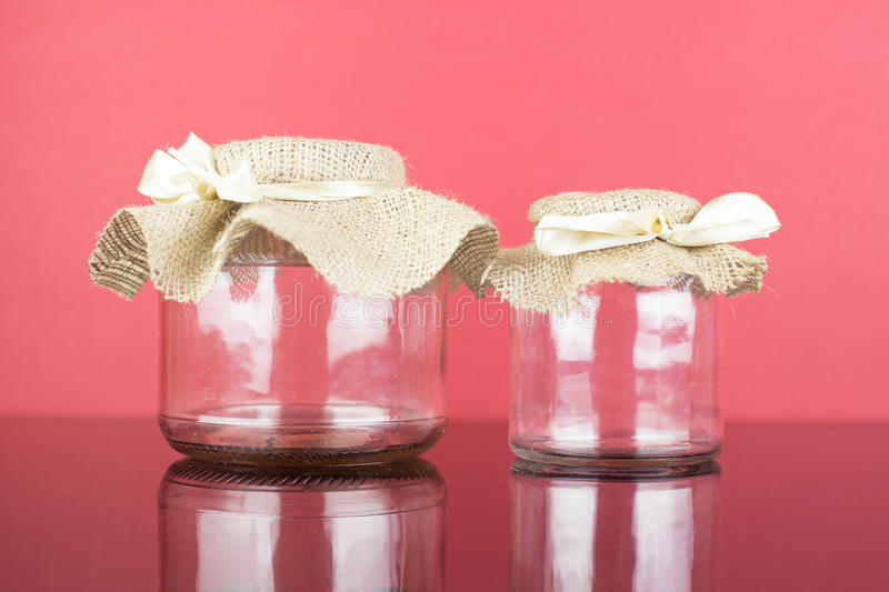 Empty glass jar with packaging sacking stock photos