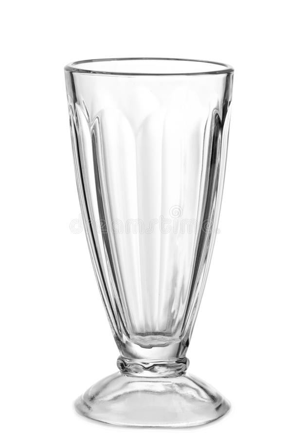 Empty glass for a milkshake. On a white background royalty free stock photos