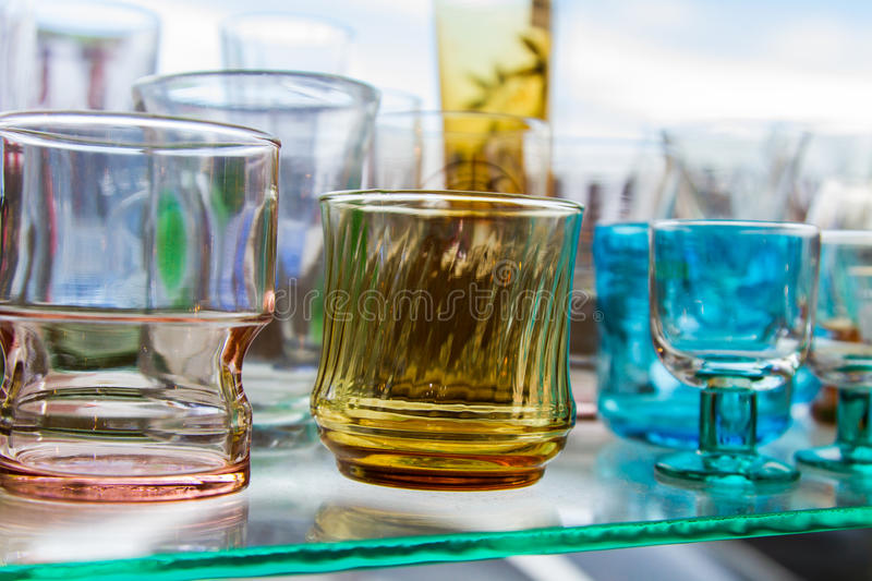 Empty glass of water used in the beverages. Glass of water cascaded into multiple containers that brought many popular home decorating stores or the collection royalty free stock image