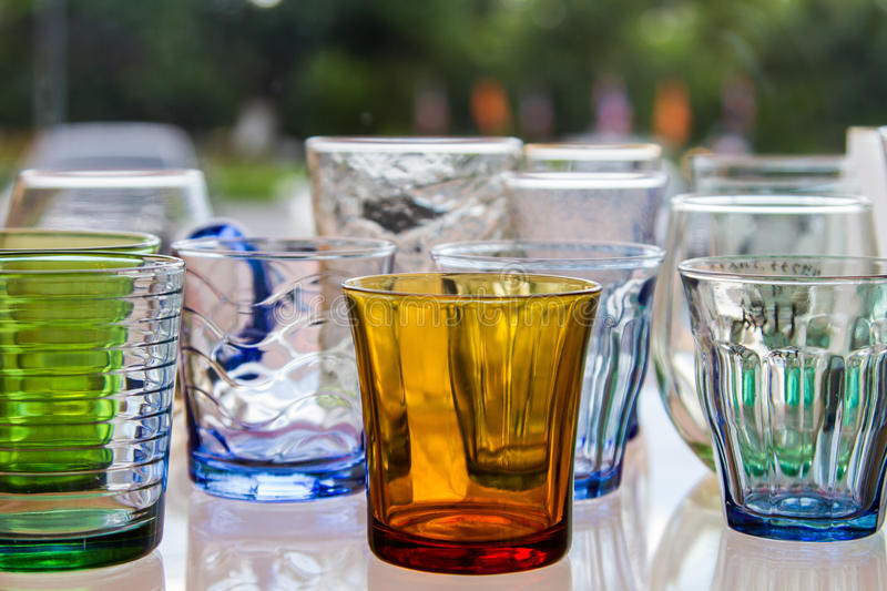 Empty glass of water used in the beverages. Glass of water cascaded into multiple containers that brought many popular home decorating stores or the collection royalty free stock photography