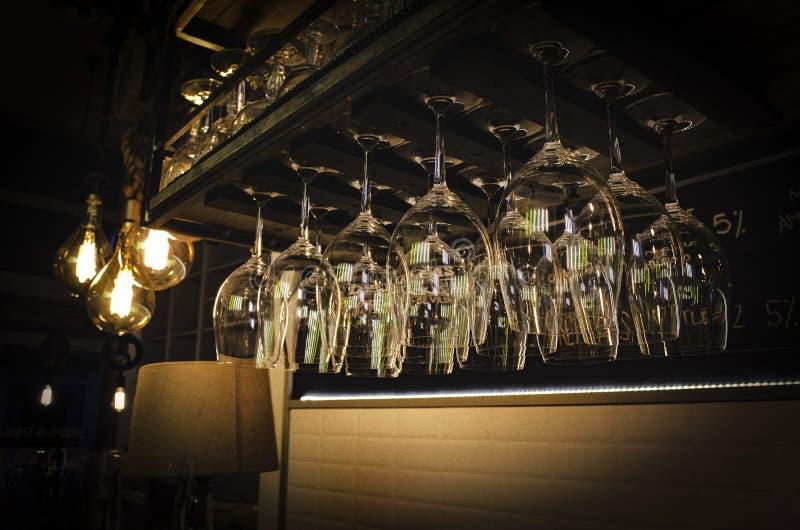 Empty glasses of beer or wine in shelf/ Vasos de cerveza o vino vacíos colgados stock photos