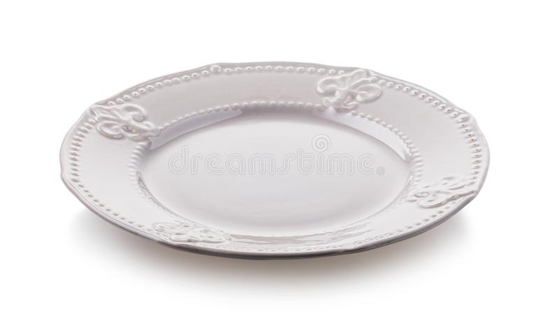Empty glossy ceramic plate isolated on white background stock image