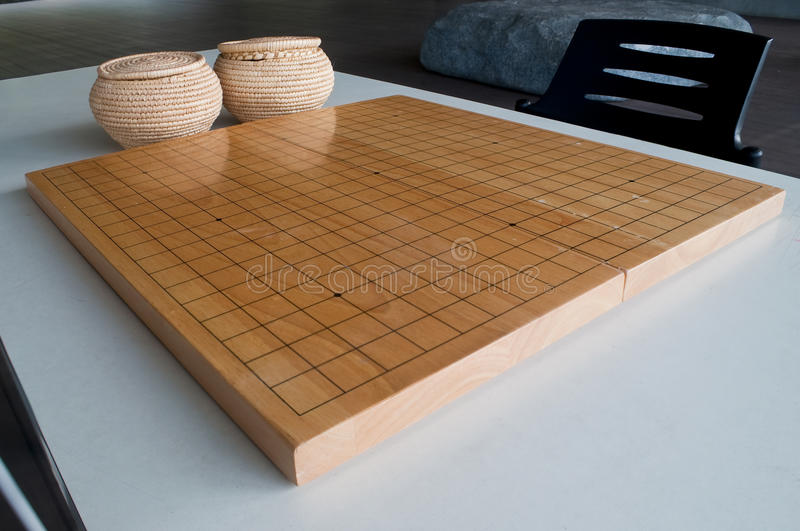 Empty Go board. With two basket of stone pieces stock photo