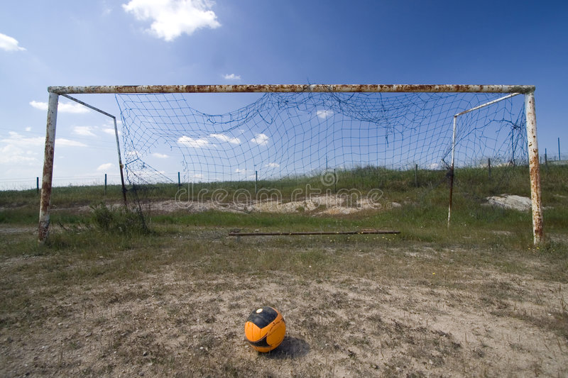 Empty goal in a field. Empty goal in a abandoned field stock photos