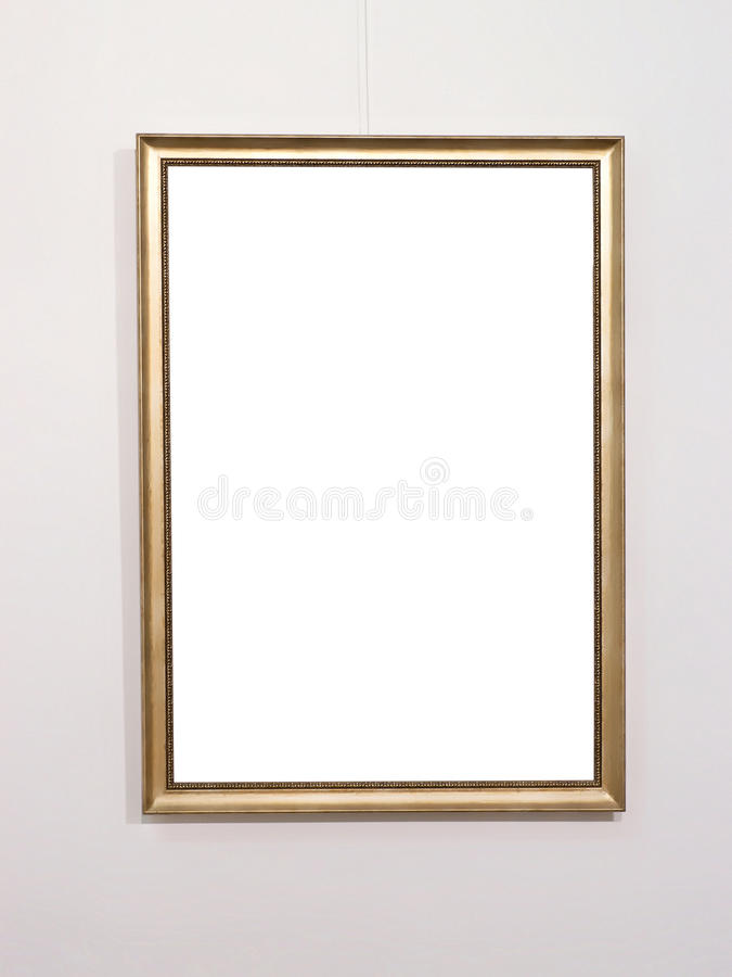 Empty golden picture frame on white wall. Copy space into frame royalty free stock image