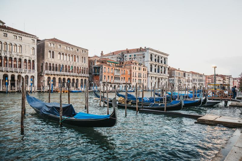 Empty gondolas moored on Grand Canal in Venice, Italy. royalty free stock image