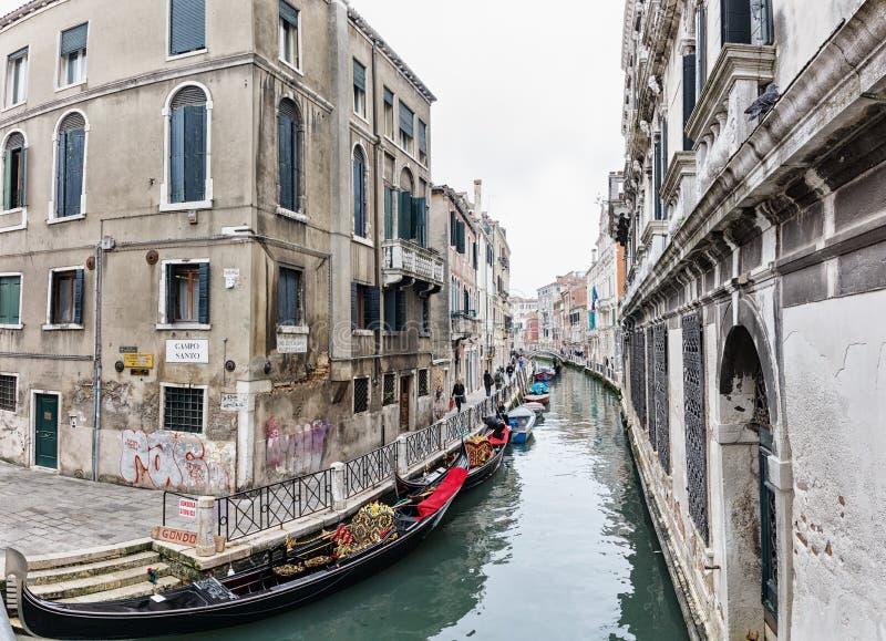 Empty gondolas on a small Venetian canal. stock photography